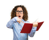 Shocked woman reading book — Stock Photo