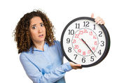 Woman, worker, holding clock looking anxiously, pressured by lack of time — Foto de Stock