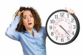 Woman, worker, holding clock looking anxiously, pressured by lack of time — Photo