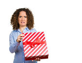 Displeased woman holding opening christmas red gift box — Stock Photo