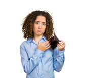 Broke woman with empty wallet — Stock Photo