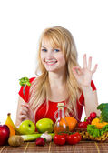 Healthy woman eating fruits vegetables — Stock Photo