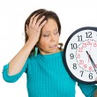 Senior woman holding clock looking anxiously pressured by lack of time — Stock Photo #53692893