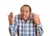 Rude, difficult, angry young man gesturing with fingers are you crazy? — Stock Photo