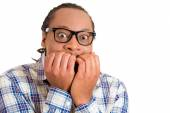 Scared stressed worried anxious looking man biting nails — Stock Photo