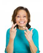 Mature, funny looking woman crossing fingers — Stock Photo