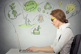 Woman working on computer solving ecology, renewable energy problem — Foto de Stock