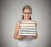 Teenager girl student holding pile of books — Stock Photo