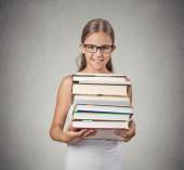 Teenager girl student holding pile of books — Stockfoto