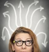 Girl thinking looking for solution uncertain — Stock Photo