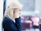 Unhappy young business woman — Stock Photo