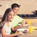Children eating breakfast — Stock Photo #55012525