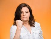 Angry woman putting up fist warning — Stock Photo