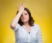 Woman with palm on face gesture in duh moment — Stock Photo
