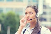 Serious female customer service representative — Stock Photo
