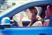 Angry aggressive woman driving car — Stock Photo