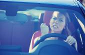 Angry aggressive woman driving car — Foto Stock