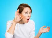 Nosy woman with hand to ear gesture  — Stock Photo