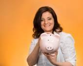 Woman holding piggy bank — Stock Photo