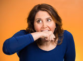 Crazy woman going nuts biting her arm  — Stock Photo
