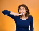 Woman brushing teeth with toothpaste, manual toothbrush — Stock Photo
