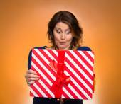 Woman opening red gift box, surprised — Stock Photo