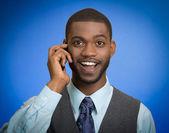 Happy man talking on phone — Stock Photo