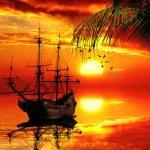 Old sailboat on a sunset skyline — Stock Photo #56117911