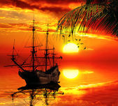 Old sailboat on a sunset skyline — Stock Photo