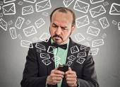Business man busy sending messages emails from smart phone  — Stock Photo