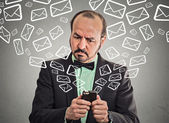 Business man busy sending messages emails from smart phone  — Stock fotografie