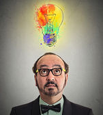 Man having brilliant idea lightbulb above head — Foto de Stock