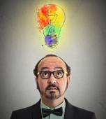 Man having brilliant idea lightbulb above head — Stockfoto