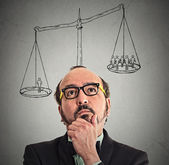 Businessman with scale above head — Stock Photo