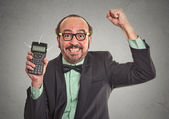 Businessman showing calculator with million sign on screen — Stock Photo