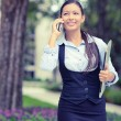 Successful businesswoman young entrepreneur talking on cellphone while walking outdoor — Stock Photo #57126247