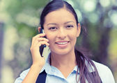 Happy beautiful woman smiling speaking on mobile phone — Stock Photo
