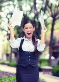 Successful business woman with arms up celebrating. — Stock Photo