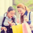 Happy, laughing young shopper women — Stock Photo #57594773