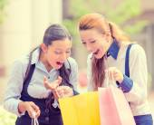 Happy, laughing young shopper women  — Stock Photo