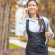 Businesswoman talking on cell phone outside on a city street — Stock Photo #57694841