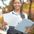Businesswoman standing holding company documents — Stock Photo #57694905