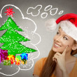 Woman in red santa helper hat looking at christmas tree — Stock Photo #57695603