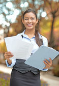 Businesswoman standing holding company documents — Stock Photo