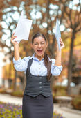 Successful business woman with arms up celebrating — Stock Photo