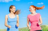 Two happy girls runners. — Stock Photo