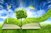 Green micro world, book covered with green grass wind energy turbines installed — Stock Photo