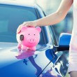 Woman customer, agent and new car, pink piggy bank key on hood — Stock Photo #58514975