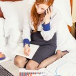 Business woman talking on mobile phone working on laptop in hotel room — Stock Photo #58815685