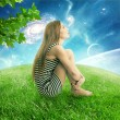Woman sitting on on a green meadow earth planet looking up at starry sky — Foto Stock #58819065